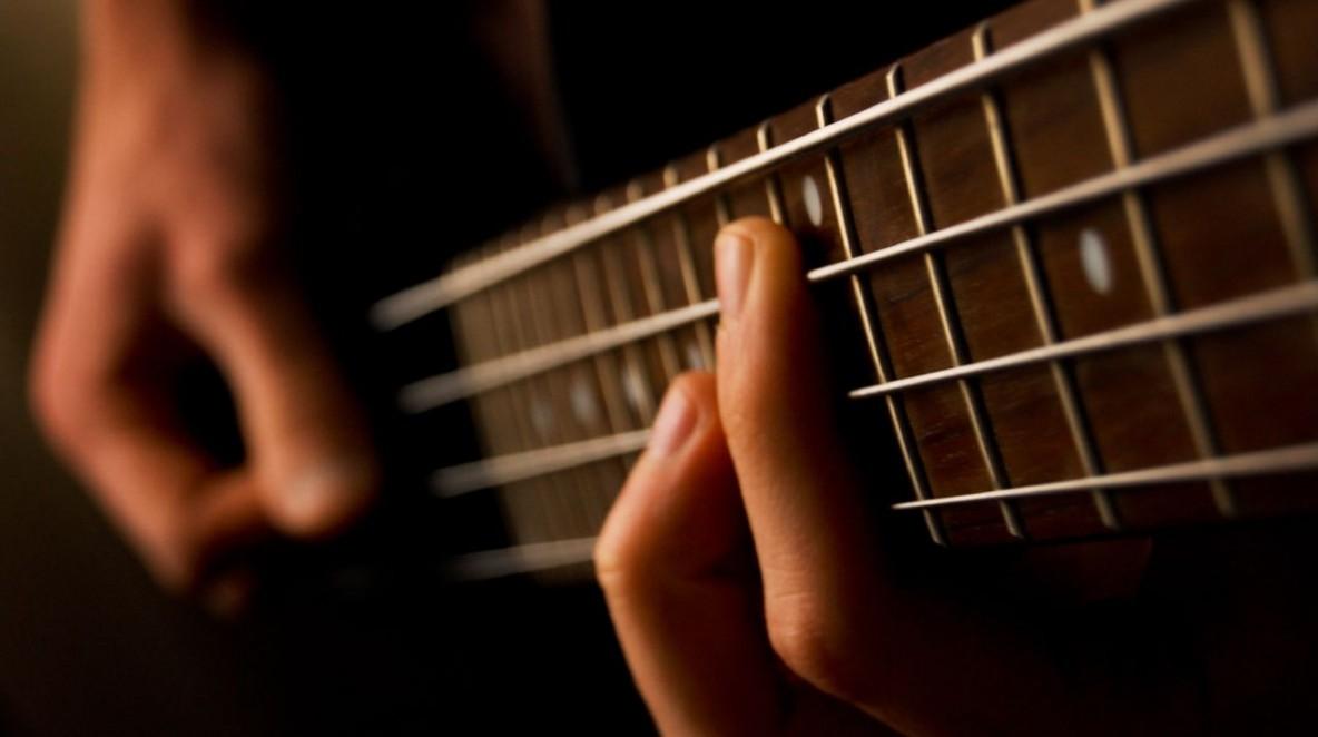 """Bass Guitar"" by Feliciano Guimarães. https://www.flickr.com/photos/jsome1/477085398"